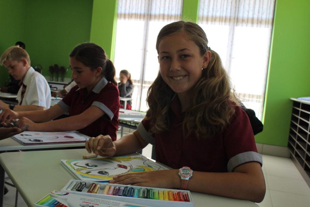 Student doing art in art class